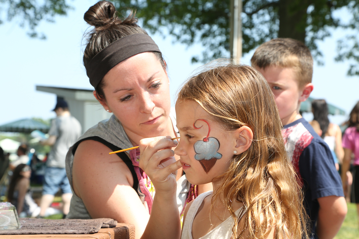 girl getting face painted