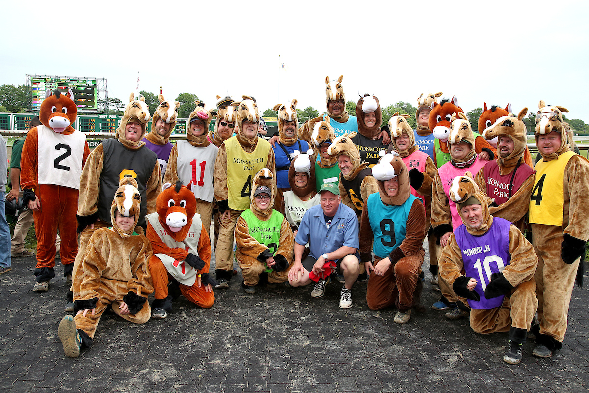 people in horse costumes
